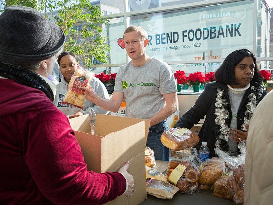 John Deere employees help with a food drive